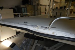 Fiberglass damage on a center console boat - JDOC Marine LLC