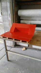 Custom fiberglass mold for housing electrical components, completed with red paint and varnish - JDOC Marine LLC
