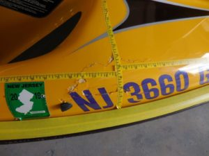 Sever Fiberglass damage on a yellow Wave Runner - JDOC Marine, LLC