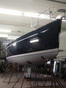 Black sailboat with gelcoat application - JDOC Marine LLC