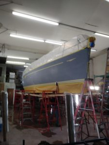 Sailboat awaiting repair in shop - JDOC Marine LLC