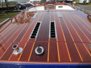 Beautifully crafted wood boat with high gloss varnish application - JDOC Marine LLC