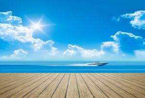 Speed boat on the ocean view from a dock - JDOC Marine LLC