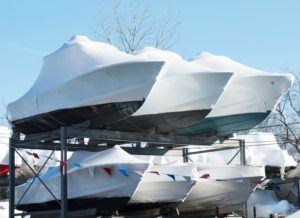 Boats shrink wrapped and stored for transport - JDOC Marine LLC